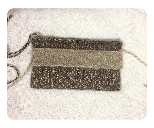 Knitted purse after blocking