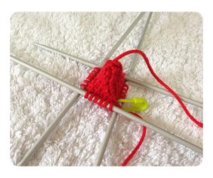 Strawberry knitting progression round 10